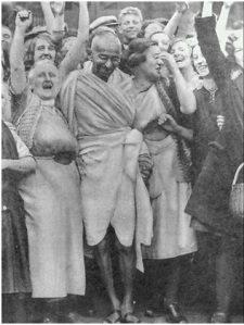 """Be the change you wish to see in the world,"" Mahatma Gandhi with textile workers at Darwen, Lancashire, England, September 26, 1931, origin unknown, via wiki commons"